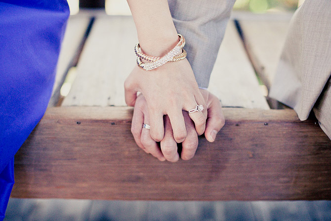 holding each other's hands engagement ring